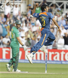 India's RP Singh, right, celebrates clean bowling South Africa's Herschelle Gibbs. AP