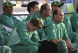 South Africa's Jacques Kallis, foreground right sits on the team bench, during their semi final Twenty20 World Cup cricket match against Pakistan. AP