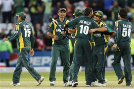 Pakistan players including man of the match Shahid Afridi, centre right, celebrate their semi-final win over South Africa. AP