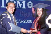 Rekha Sashikumar receiving a medal from Madhavan Nair.
