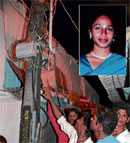 Onlookers check the loose electric wires which claimed the life of Preethi S