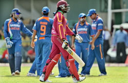 West Indies cricket team captain Chris Gayle (C) leaves the field after being dismissed as Indian players celebrate. AFP