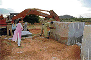 Tahsildar Dr Roopashree having a look at the granite blocks and other materials seized near Surappanahalli of Bagepalli taluk on Monday. DH photo