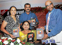 Proud moment: Former Indian stumper Syed Kirmani (right) releases the authorised biography of paralympian Malathi Holla (centre) as former athlete Ashwini Nachappa and author Ananth Krishnan M look on in Bangalore on Wednesday. DH photo