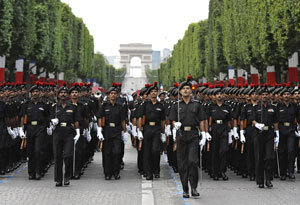 Indian Army guest-troops march down the Champs Elysees avenue during rehearsal early on on Saturday, in Paris, in preparation of the Bastille Day parade. AFP