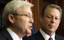Former U.S. Vise President Al Gore, right, looks on as Australia's Prime Minister Kevin Rudd speaks during a joint press conference in Sydney, Australia, Wednesday, July 15, 2009. Gore has backed the Rudd government's decision to push ahead with emissions trading legislation before the global December Copenhagen summit.