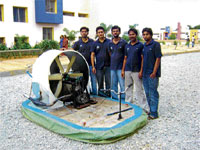 The team poses with the hovercraft, designed and created by them.