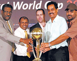 From left: Clive Lloyd, Aravinda de Silva, Michael Bevan, Dilip Vengsarkar and Balvinder Sandhu pose with the 2011 WC trophy on Tuesday. PTI