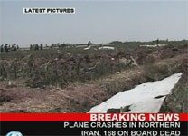 This image made from television broadcast by Iran's Press TV, Wednesday, shows they say wreckage from the crashed Iranan passenger plane. AP