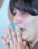 An Armenian woman cries at the Yerevan airport on Thursday before boarding a plane to Tehran to indentify the bodies of her relatives. AFP