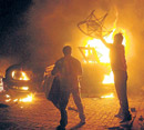 passion by fire: BSP activists set on fire the house of Uttar Pradesh Congress chief Rita Bahuguna in Lucknow late on Wednesday night. pti