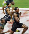 Usain Bolt races past Daniel Bailey (left) and Yohan Blake (second from left) to win the 100M gold. afp