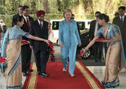 US Secretary of State Hillary Clinton being welcome by hotel staff during her arrival at Taj Hotel in New Delhi. AP