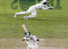 smart work Tillakaratne Dilshan takes a sharp catch to get rid of Misbah-ul-Haq on day one of the third Test. reuters