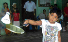 in fine touch: Ashwini Bhat returns during her win over Mithula UK in the girls' under-10 final on Monday. dh photo