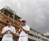 England's Andrew Flintoff, left, and Andrew Strauss in front of the pavilion at Lord's cricket ground.