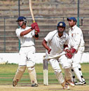 Heave ho!: City XI's Kunal Kapoor hits a boundary en route his unbeaten 88 against Combined XI on the opening day of the three-day Safi Darashah cricket tie on Tuesday. DH photo