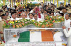 MORTAL REMAINS: Chief Minister B S Yeddyurappa, Assembly Speaker Jagadish Shettar, Leader of the Opposition in the Assembly Siddaramaiah, and Council Chairman Veeranna Mathikatti paying their last respects in Hubli on Tuesday. DH PHOTO