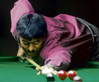 FOCUSED B Bhaskar is poised to score against K S Naveen in the State-ranking snooker tourney on Wednesday. DH PHOTO
