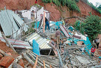 Five houses were demolished by TMC officials at Rifle Range in Madikeri on Wednesday.