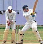 CLASS ACT: Combined XI's Bharath Chipli cuts during his knock of 74 against City XI in the Safi Darashah cricket tournament on Wednesday. DH PHOTO