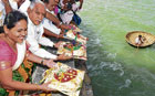 thanksgiving: Chief Minister B S Yeddyurappa offering bagina to River Cauvery at Krishna Raja Sagar dam in Mysore on Friday.  Minister Shobha Karandlaje is seen. dh photo