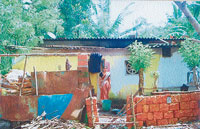 The roof of a house was damaged owing to whirlwind in Goliyangadi in Kundapur taluk on Friday.