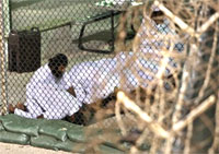 In this file photo reviewed by the U.S. military, Guantanamo detainees pray at Guantanamo Bay U.S. Naval Base in Cuba. AP