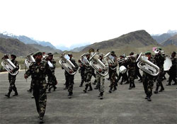 Army band reherses on the eve of Kargil Victory day celebrations in Drass on Friday. PTI