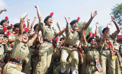 BSF women cadets of the first batch jubilate during their passing-out parade at a training centre in Hoshiarpur on Saturday. PTI