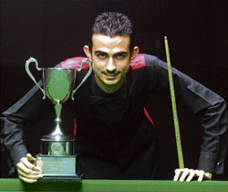 State-ranking Junior snooker champion Mundir Sherazi poses with his trophy at the KSBA Hall. DH photo