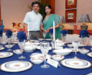 fine craft Purnima and Sunil Sethi with a dinnerware display.
