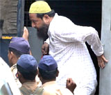 Hanif Sayyed, accused in 2003 twin blasts case on his way to a special POTA court in Mumbai on Monday. PTI