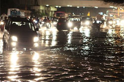 Heavy showers cripple life in Delhi, water logged roads block the traffic. PTI