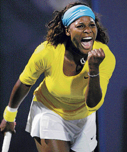 Serena Williams exults after defeating China's Li Na in the first round of the Stanford Classic on Tuesday. Reuters