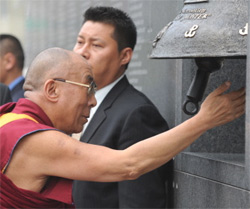 Dalai Lama rings a bell at a museum in Warsaw dedicated to the ill-fated 1944 Warsaw uprising against the Nazis. AFP