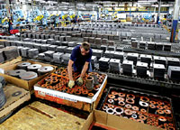 An employee on duty at the Baldor Electric factory in St. Louis.  The government reading on US  gross domestic product released Friday was better than economists expected. AP