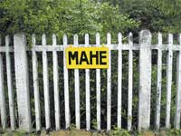 We Are Here: The board announcing 'Mahe' at the railway station.