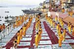 Selling Spirituality: A religious ceremony in progress on the ghats of the Ganga. Photo by Somit Bardhan
