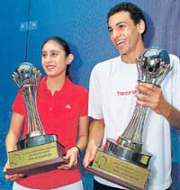 WINNERS: Egyptians Mohammad El Shorbagy (right) and Nour El Sherbini display their spoils after winning at the World Junior squash tournament in Chennai on Sunday. PTI