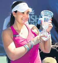 ALL SMILES: France's Marion Bartoli shows the trophy after winning the Stanford Classic tennis tourney on Sunday. AP