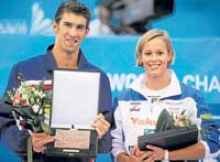 CHAMPION PAIR: American sensation Michael Phelps (left) and Italian Federica Pellegrini were named the best swimmers at the World Championships in Rome. AFP