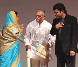 President Pratibha Patil felicitates Gulzar and A R Rahman after special screening of