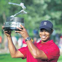 THE SMILE'S BACK!  World number one Tiger Woods with the Buick Open trophy he won on Sunday. AP