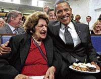 US President Barack Obama and veteran White House reporter Helen Thomas in the White House Press Briefing Room in Washington on Wednesday. AP