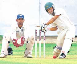 FINE SHOT: Railways'  V Cheluvaraj drives en route to his knock of 96 against Tamil Nadu at the Chinnaswamy stadium in  Bangalore on Tuesday. DH Photo