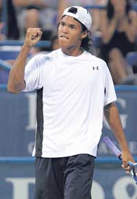 Somdev Devvarman celebrates after his win over Marin Cilic on Tuesday. AFP