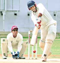 GOOD KNOCK: KSCA XI 's B Akhil in full cry en route to his 86 against ONGC in Bangalore on Thursday. DH photo