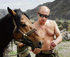 Russian Prime Minister Vladimir Putin with a horse during his vacation outside the town of Kyzyl, Siberia, on Monday. AFP
