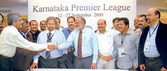 WELL DONE! KSCA President Srikantadatta Narasimharaja Wadiyar, Secretary Brijesh Patel and some of the bidders for the Karnataka Premier League teams at the Chinnaswamy Stadium in Bangalore on Wednesday. DH photo